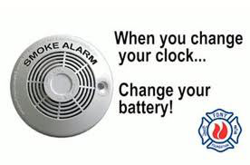 Photo of smoke alarm with text reminding you when you change back your clock to change your battery