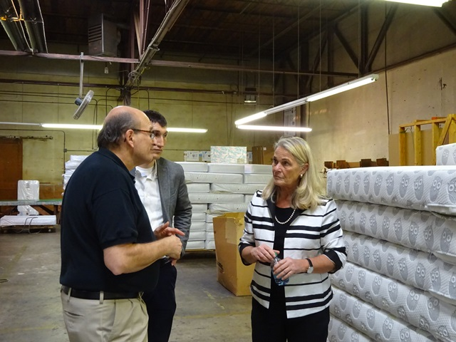 Commissioner Buerkle talking to a representative of Colgate Mattress