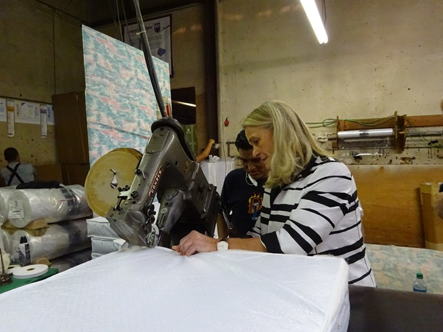 Commissioner Buerkle watching a mattress being manufactured